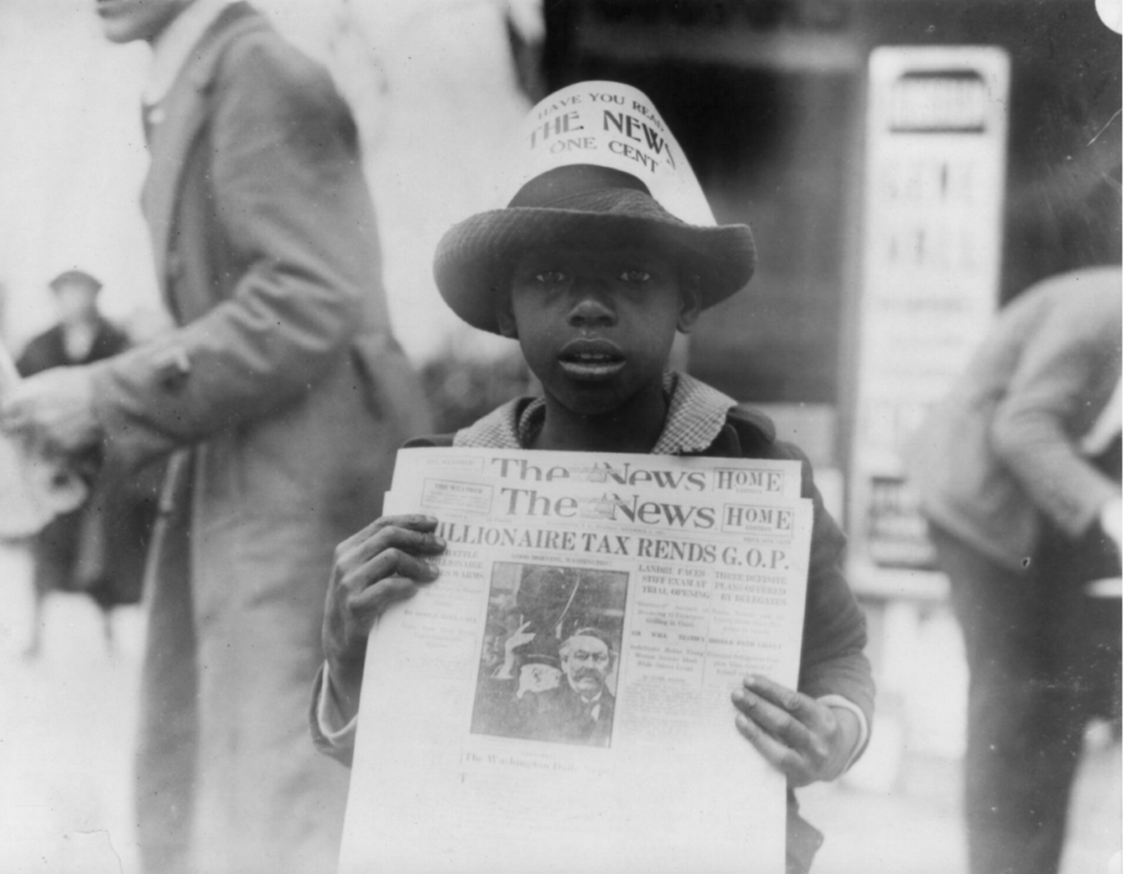 African American Research by popular US professional genealogy services, Lineages: image of a African American boy holding a newspaper.